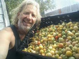 Joseph Lofthouse shows off his tomatoes in various colors and sizes.